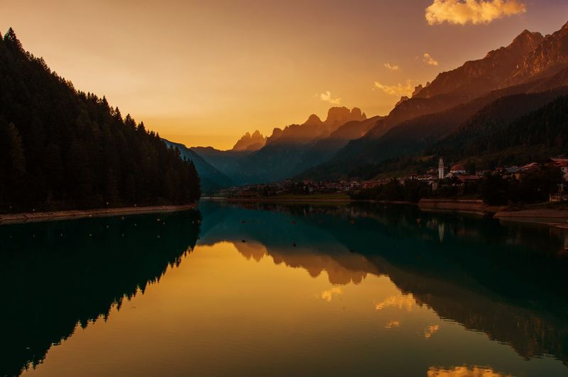 Dolomites Sunset in the Auronzo Di Cadore, Norther Italy, Europe. Scenic. Santa Caterina Lake Auronzo Di Cadore Beauty In Nature Day Lake Mountain Mountain Range Nature No People Outdoors Reflection Scenics Sky Sunset Tranquil Scene Tranquility Tree Water Waterfront