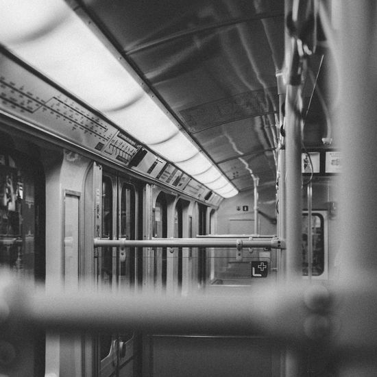 Architecture Blackandwhite Building Built Structure Ceiling Communication Day Focus On Background Indoors  Mode Of Transportation No People Passenger Train Public Transportation Rail Transportation Reflection Selective Focus Subway Subway Train Subwayphotography Train Train - Vehicle Transportation Ubahn Vehicle Interior Window