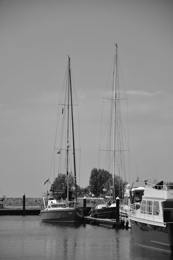 Architecture Day Harbor Marina Mast Mode Of Transportation Moored Nature Nautical Vessel No People Outdoors Pole Sailboat Sea Sky Transportation Travel Water Waterfront Yacht