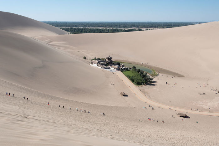 The Singing Sand Dunes of Dunhuang, Gansu, China ASIA Dessert Gobi Desert Silk Road Arid Climate Beach Beauty In Nature China Clear Sky Day Desert Gansu Horizon Over Water Landscape Large Group Of People Men Nature Outdoors People Real People Sand Sand Dune Scenics Sea Sky Tranquil Scene Tranquility Travel Destinations Lost In The Landscape