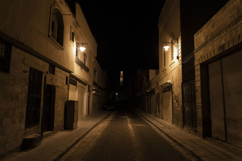 Architecture Night Illuminated The Way Forward Direction Building Exterior Built Structure Street Building City Lighting Equipment No People Street Light Diminishing Perspective Footpath Residential District Empty Outdoors Transportation Travel Destinations Alley Long