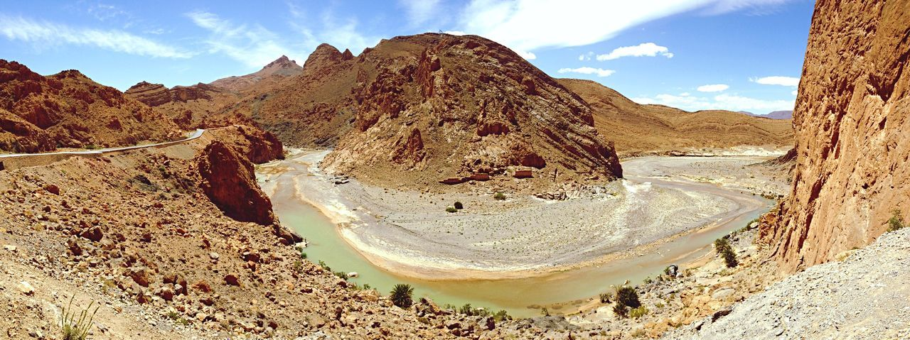 Canyon in Morocco Desert .. just a little line of Water . Hot Landscape Hot Colors