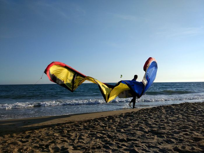 Barcelona Castelldefels Beach Sea Sand Kite - Toy Horizon Over Water Vacations Multi Colored Outdoors Sunset Sky One Person Adults Only Adventure Day Windsurfing Kiteboarding One Man Only Nature Wave People Surf Close-up