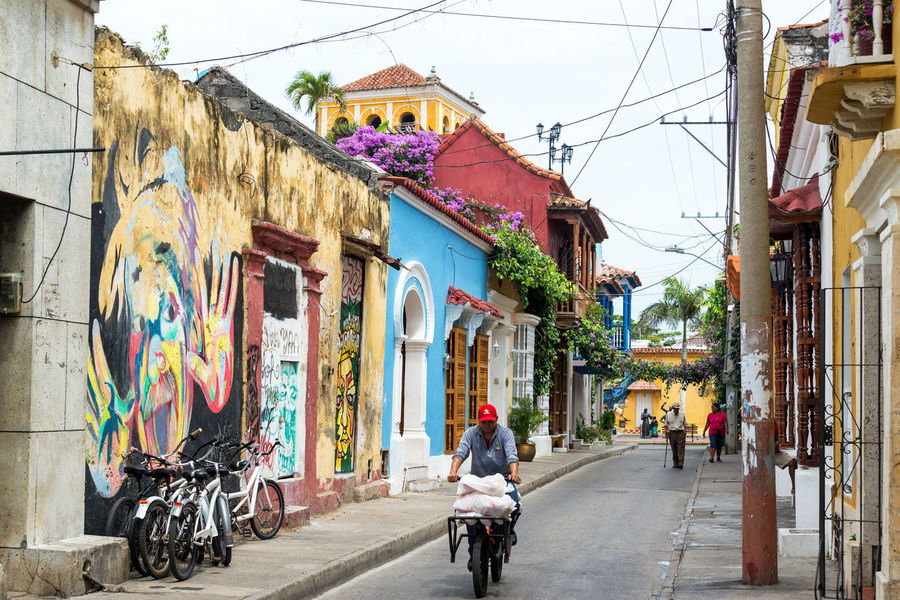 CARTAGENA, COLOMBIA - MAY 24: Colorful street view in the Getsemani neighborhood in Cartagena, Colombia on May 24, 2016 Architecture Bolivar Building Caribbean Cartagena City Colombia Colombian  Colonial Getsemane Getsemani Historic History Juice Landmark Men Old Outdoor Shop Southamerica Street Tourism Travel Urban Vendor