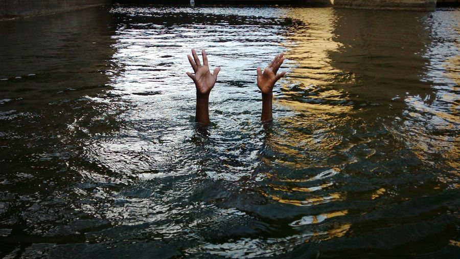 Person drowning in river
