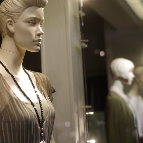 Fashion Human Representation Store Mannequin Indoors  Retail  Clothing Retail Display Reflection Shopping Female Likeness Representation People Consumerism Elégance Window Display Lifestyles Focus On Foreground Looking Beautiful Woman