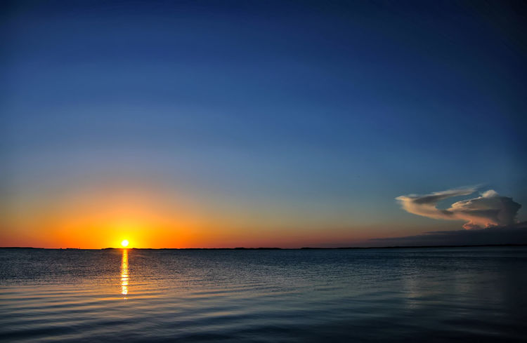 Sunset in the Florida Keys... Atmosphere Atmospheric Mood Beauty In Nature Cloud Dramatic Sky Idyllic Moody Sky Nature Orange Color Reflection Rippled Scenics Sea Seascape Sky Sky And Clouds Sun Sunbeam Sunset Tranquil Scene Tranquility Vacations Water Water Surface Waterfront