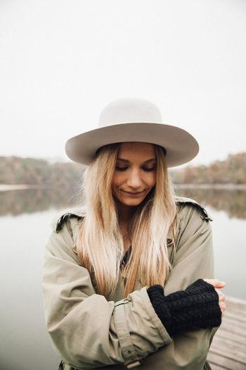 Portrait of woman wearing hat standing in winter