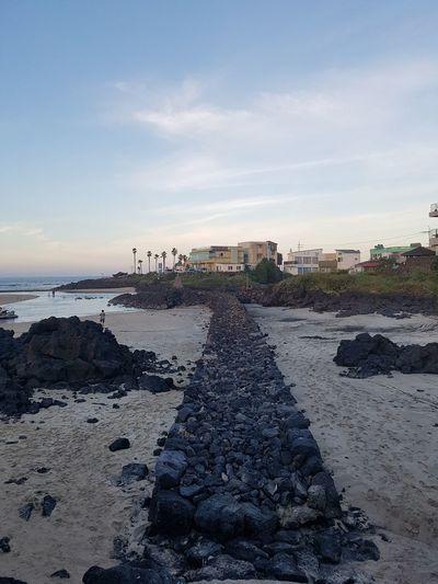 stone wall on the beach EyeEm Gallery Stone Wall Black Stone Water Sea Beach Sand Wave Summer Sunset Sky