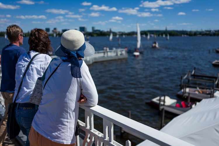 Hamburg Alster area Adult Clothing Day Leisure Activity Lifestyles Looking At View Men Mode Of Transportation Nature Nautical Vessel Outdoors People Railing Real People Rear View Sea Standing Three Quarter Length Transportation Warm Clothing Water Women