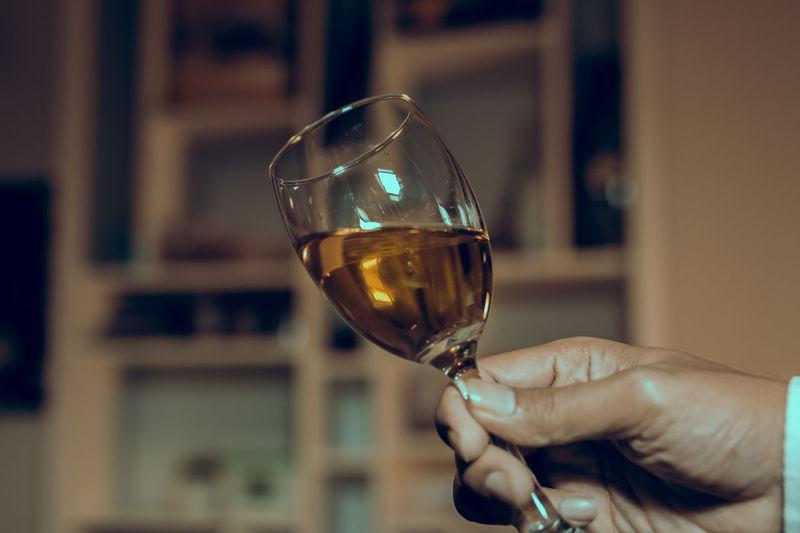 hand and wine