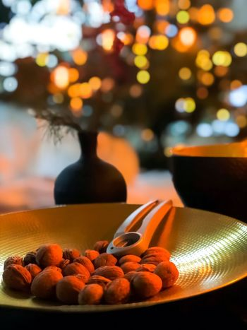Comfy  Ambiance Ambiente Warm Livingroom Home Cosy Christmas Tree Walnut Still Life Table Food And Drink No People Indoors  Food Focus On Foreground Plate Close-up Large Group Of Objects Bowl Healthy Eating Nut - Food Freshness Day