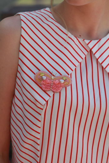 Midsection of woman wearing striped top