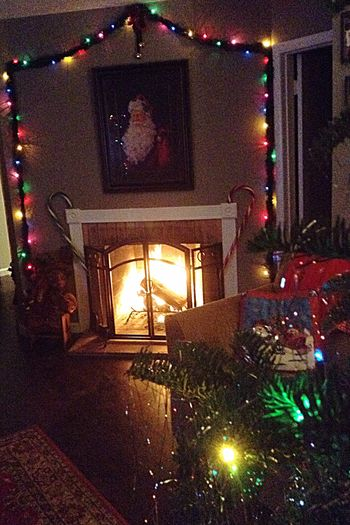 December Warmth Christmas Eve Christmas Atmosphere Glowing Christmas Lights Cozy Fireplace Christmas Memories Christmas Decorations Christmas Spirit Family Traditions