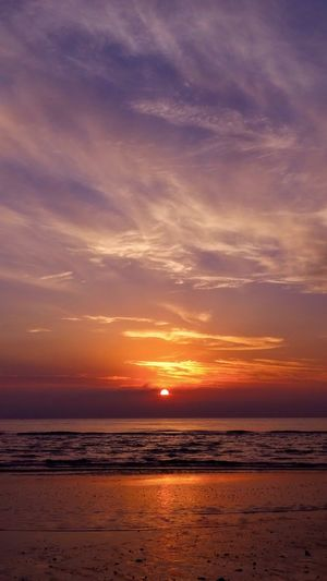 Sunset Sea Scenics Tranquility Nature Beauty In Nature Tranquil Scene Beach Sky Horizon Over Water Water Idyllic Silhouette Outdoors Sun Cloud - Sky No People Sand Travel Destinations