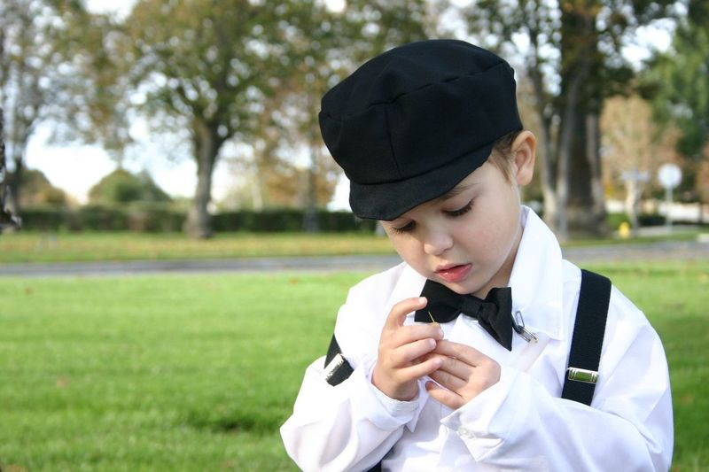 Close-Up Of Boy Looking At Needle In Park