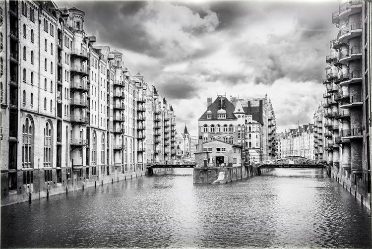 Moated castle in Hamburg's Hafencity in black and white Castle Architecture Bridge Building Building Exterior Built Structure Canal City Cloud - Sky Day Outdoors Residential District Sky Water Waterfront