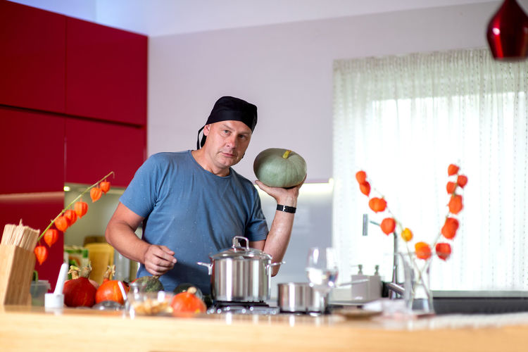Man preparing food on table at home