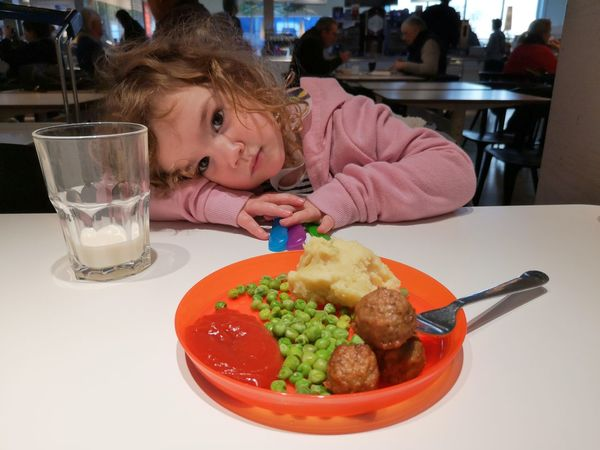 Girl not eating food at IKEA. Mashed Potatoes Gravy