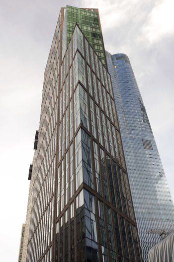 New and modern skyscrapers and buildings in NYC Architecture Building Exterior Low Angle View Built Structure Building City Modern Sky Tall - High Office Building Exterior Glass - Material Office Day No People Skyscraper Tower Nature Cloud - Sky Outdoors Financial District  New York