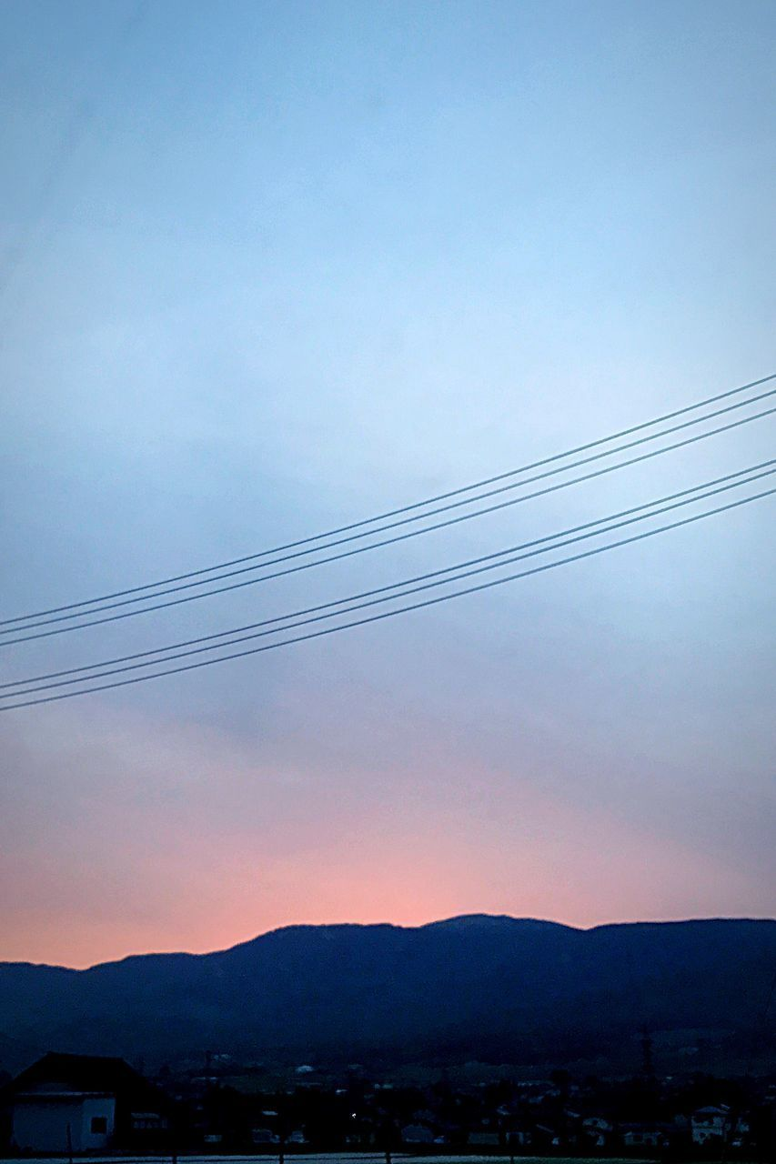 sky, no people, sunset, building exterior, built structure, silhouette, scenics, nature, cable, outdoors, beauty in nature, architecture, mountain, electricity pylon, clear sky, day