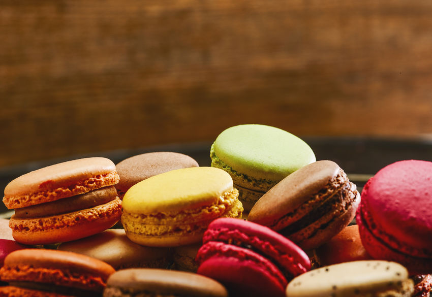 macaron or macaroon in different colors, including copy space Belgium Colors Cookies Copy Space Dessert France Green Macaroons Pink Sugar Biscuit Candy Colorful Colorfull Confectionery Flavor Food French Macaron Many Pastry Sandwitch Sweet Sweet Food Tasty