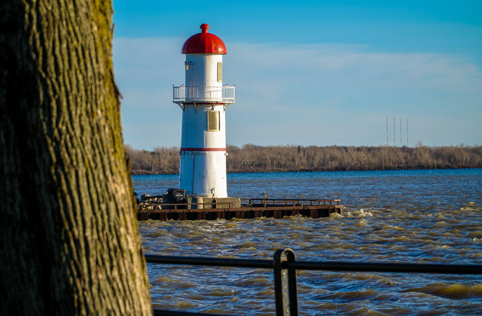 Lachine Lachine Canal Montreal Architecture Beauty In Nature Building Exterior Built Structure Canada Coast To Coast Day Direction Guidance Lighthouse Nature No People Outdoors Protection Safety Sea Sky Water Wooden Post