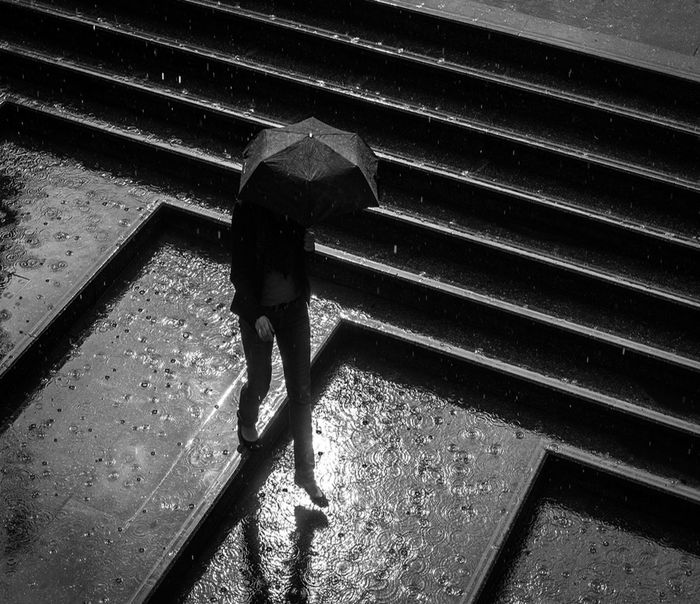 Rainy days. Real People One Person Architecture Full Length Lifestyles High Angle View Day Walking Shadow Steps And Staircases Staircase Sunlight Built Structure Adult Nature Standing Rear View Outdoors Leisure Activity Rain Rainy Days Nature Stairs person Rain