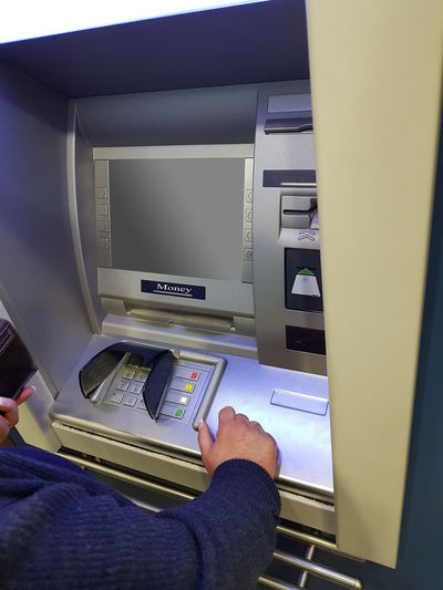 Woman at an ATM cash machine with leeen screen Adult Arts Culture And Entertainment Bank Banking Business Close-up Computer Computer Equipment Connection Credit Card Finance Hand Human Body Part Human Hand Indoors  Inserting Machinery Men One Person Real People Technology