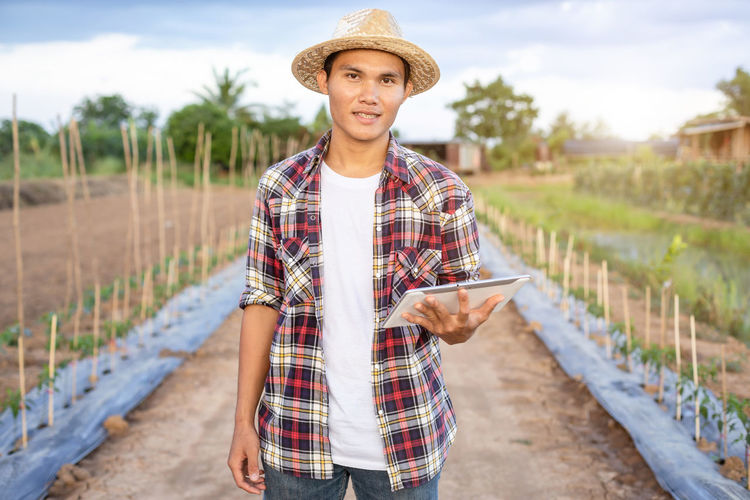 Portrait of young man standing in farm