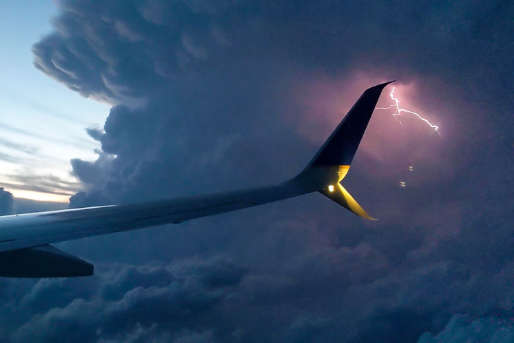 Airplane Sky Air Vehicle Cloud - Sky Flying Mode Of Transportation Transportation Nature No People Aircraft Wing Travel Journey Outdoors Mid-air Commercial Airplane Beauty In Nature Day Motion Plane Low Angle View Aerospace Industry Lightning Thunderstorm