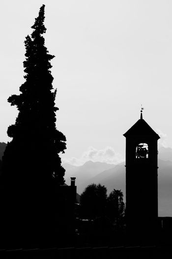 Alps Architecture Bell Tower Black And White Blackandwhite Building Exterior Built Structure Clock Clock Tower Day EyeEmNewHere No People Outdoors Place Of Worship Religion Silhouette Sky Spirituality Switzerland Tree EyeEmNewHere