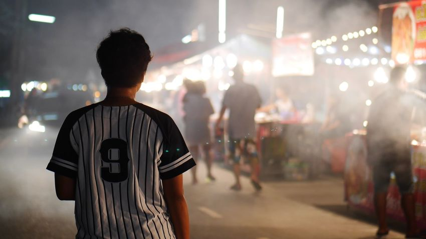 EyeEm Selects Rear View Night Text Focus On Foreground Men Real People Illuminated Soccer One Person Standing Outdoors Adult People Local Market Night Market In Thailand Festival Thailand Connected By Travel Fresh On Market 2017