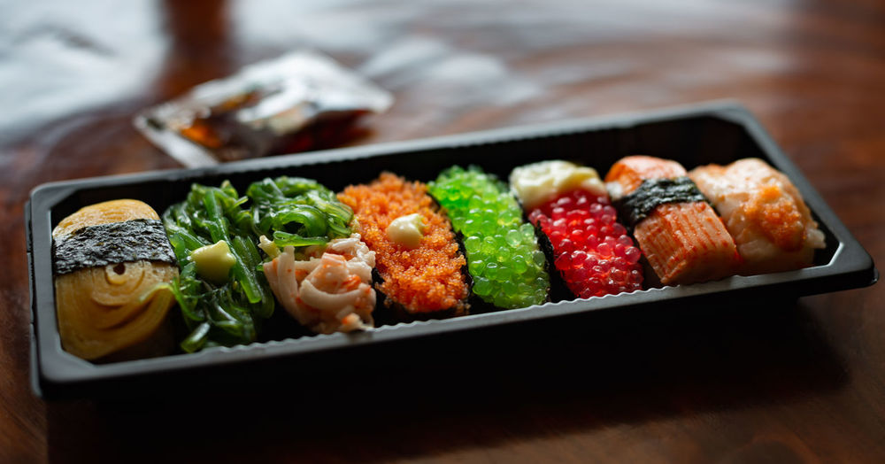 Sushi Food And Drink Food Asian Food Freshness Healthy Eating Ready-to-eat Japanese Food Indoors  Seafood Close-up Vegetable Focus On Foreground Meat No People Selective Focus Wellbeing Choice Table Variation Tray Lunch Box Dinner Crockery Street Food