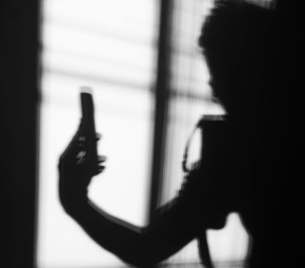Close-up portrait of silhouette woman with shadow