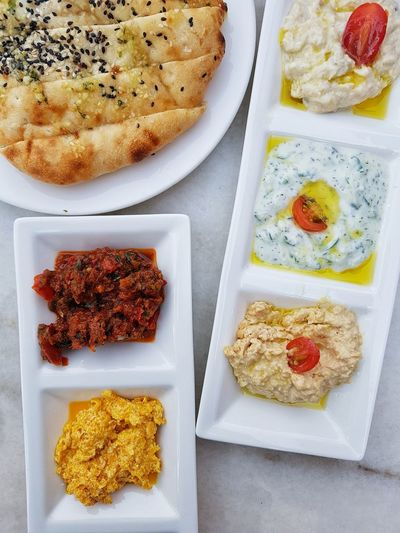 Variation Food And Drink Healthy Eating Ready-to-eat Close-up High Angle View Freshness Middle Eastern Food Turkish Food Pita Bread And Dips Dips Bread Food Spread Food On The Table Hummus Hummus And Friends