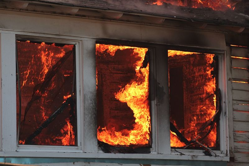 Low angle view of house in fire