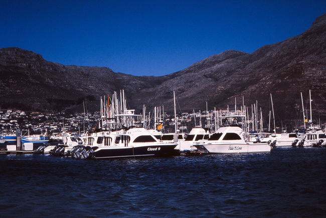 Architecture Blue Building Exterior Built Structure Clear Sky Day Film Photography Mode Of Transportation Moored Mountain Mountain Range Nature Nautical Vessel No People Outdoors Sailboat Sea Sky Slide Film Scan Transportation Water Waterfront Yacht