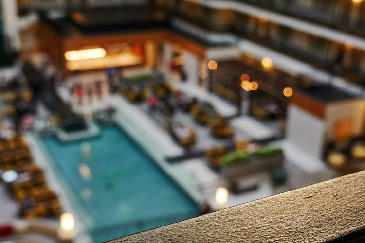 Selective Focus Architecture Built Structure Building Exterior Focus On Foreground No People High Angle View Illuminated City Outdoors Nature Swimming Pool Pool Building Travel Destinations Close-up