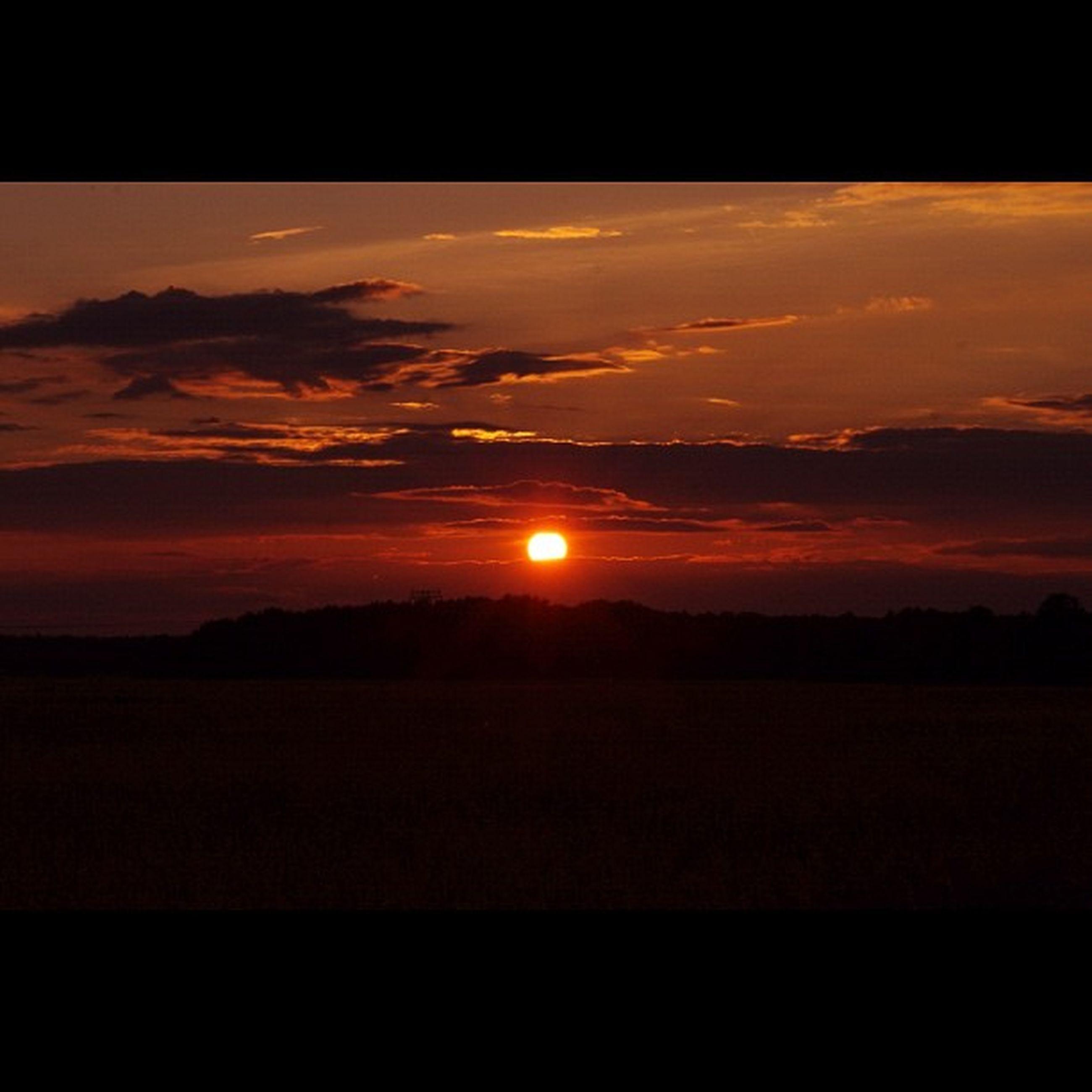sunset, scenics, silhouette, sky, orange color, tranquil scene, beauty in nature, tranquility, sun, cloud - sky, idyllic, landscape, nature, dramatic sky, cloud, dark, sunlight, moody sky, outdoors, majestic