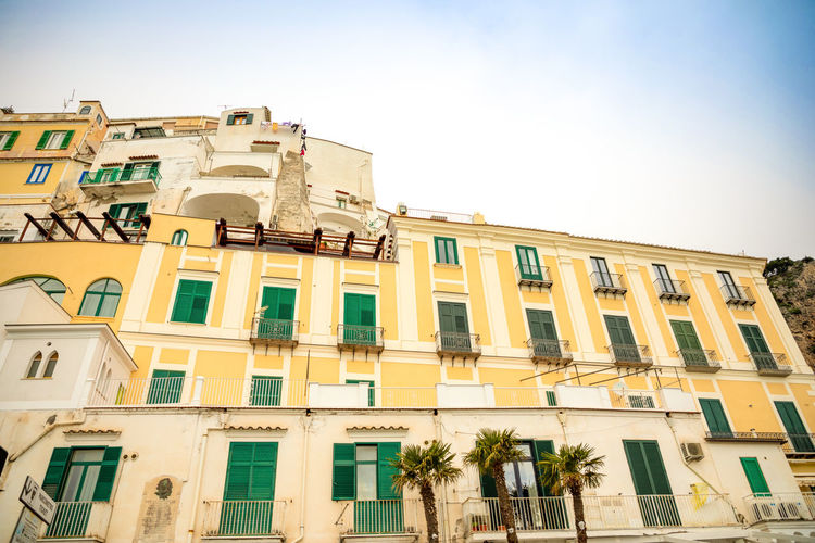 Italy Amalfi  Amalfi Coast Building Exterior Built Structure Architecture Window Residential District Sky Building Low Angle View Nature City Clear Sky Day Sunlight Outdoors No People Plant Balcony Yellow Tree Multi Colored Apartment Row House