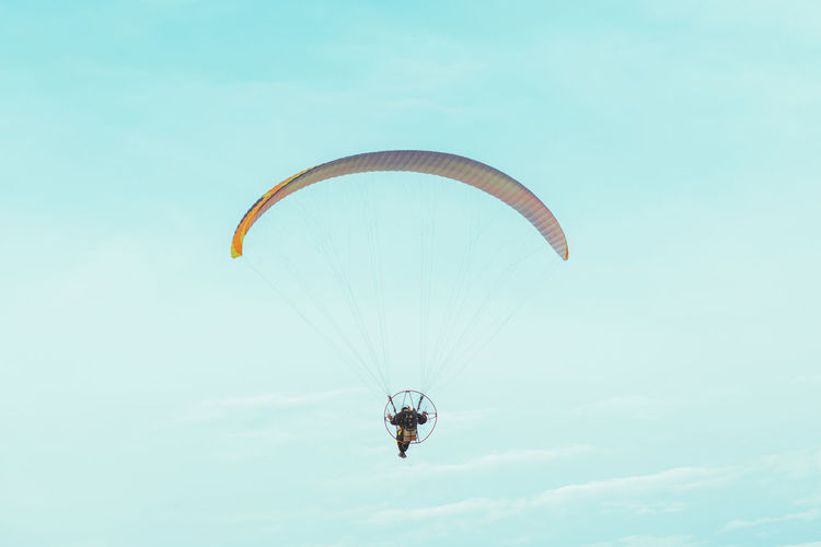 Paraglider flying in the blue sky Extreme Sports Paragliding Sport Adventure Joy Lifestyles Flying Sky Day Gliding Freedom Outdoors One Person Parachute Up Paraglider Hobby Wind Recreation  Glider Free Freedom Flight Adrenaline Fly