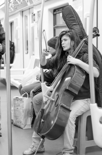 Playing cello in the subway Adult Cello Music Musician People Playing Cello Subway Subway People Subway Train Transportation Violonchelo