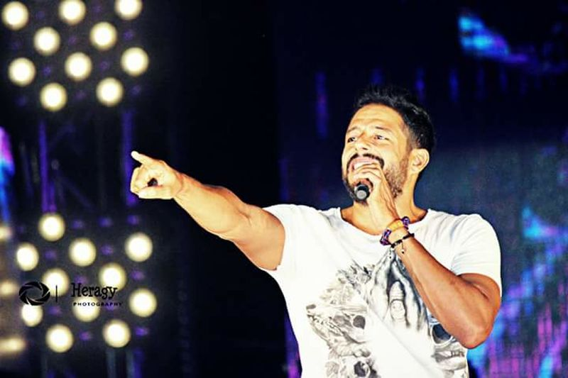 Hamaki Mohamed Hamaki Porto Sokhna Arts Culture And Entertainment One Man Only Performance Adult Only Men One Person Adults Only Music Illuminated Night Expertise Popular Music Concert Singer  Singing People Candid Microphone Performing Arts Event Excitement Nightlife