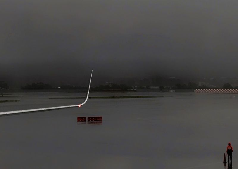 Airport activities on a rainy, foggy morning. Airport Jet Wing One Person Rain Fog Transportation Water Morning Glassy Water Business Regular Day Relfection Gray Color