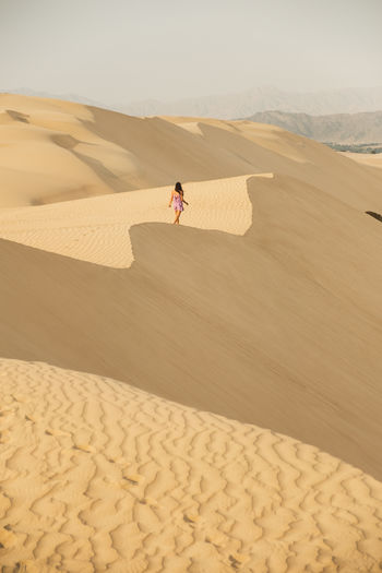 Sand Land Sand Dune Desert Arid Climate Climate Real People One Person Scenics - Nature Sunlight Nature Landscape Lifestyles Travel Non-urban Scene Outdoors Peru Peruvian Dunes Ica Oasis Oasis In The Desert