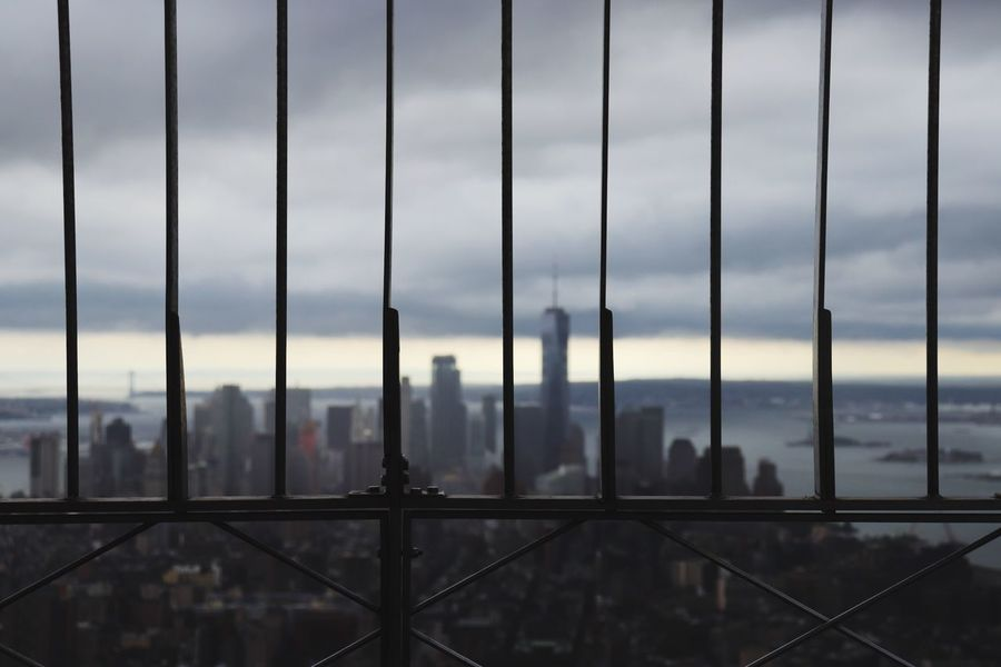 Skyline Manhattan New York Oneworldtradecenter Empire State Building EyeEm Selects Architecture Built Structure Building Exterior City Cityscape Sky Cloud - Sky Building No People Fence Skyscraper Nature Office Building Exterior Boundary Metal Travel Destinations Barrier Travel Outdoors Water