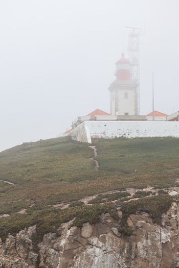 Cabo da Roca Grass Lighthouse Portugal Architecture Built Structure Cliff Fog Lonliness No People Ocean Travel