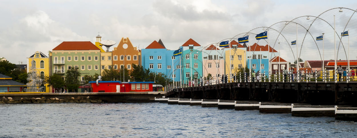 Curaçao is an island country in the southern Caribbean Sea, approximately north of the Venezuelan coast, that is a constituent country of the Kingdom of the Netherlands. Formally called the Country of Curaçao, it includes the main island and the uninhabited island of Klein Curaçao. It has a population of over 150,000 on an area of and its capital is Willemstad. Caribbean Caribbean Island Caribbean Sea Cruise Cruise Ship Curacao Curacao (willemstad) Floating Bridge Vivid International Willemstad Xmas