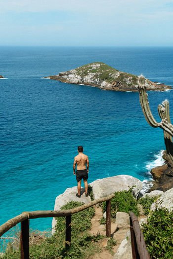 Sea Water Rear View Horizon One Person Horizon Over Water Scenics - Nature Beauty In Nature Full Length Real People Sky Leisure Activity Standing Lifestyles Nature Rock Shirtless Day Tranquil Scene Looking At View
